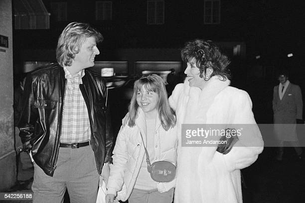 British actress Joan Collins with her 11 year old daughter Katyana from her marriage with Ron Kass and her companion Swedish singer Peter Holm during...