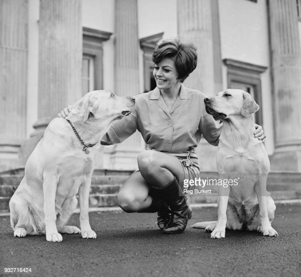British actress Joan Rice with two dogs, UK, 19th October 1968.