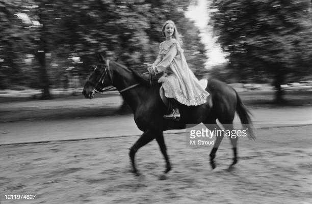 British actress Judi Bowker, one of the stars of London Weekend Television drama 'The Adventures of Black Beauty,' riding along Rotten Row in Hyde...