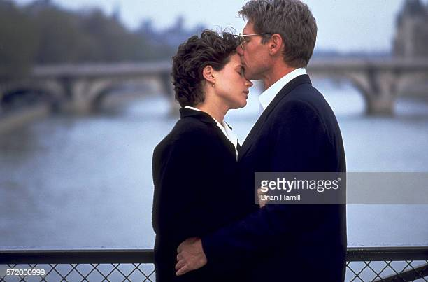 British actress Julia Ormond and American actor Harrison Ford on a bridge in the film 'Sabrina' 1995