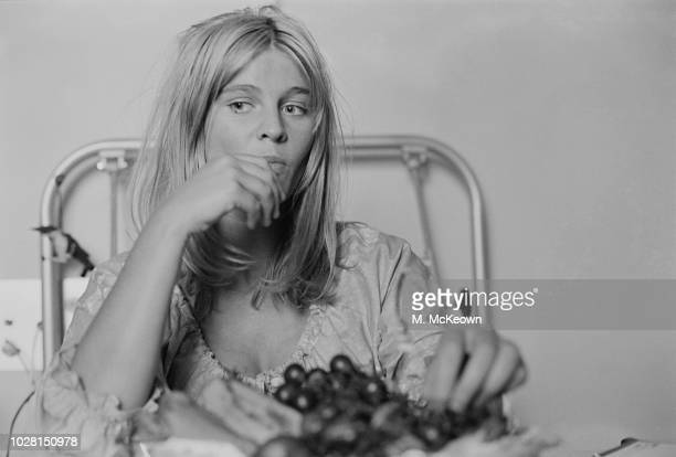 British actress Julie Christie eating grapes while in a hospital bed UK 11th August 1964