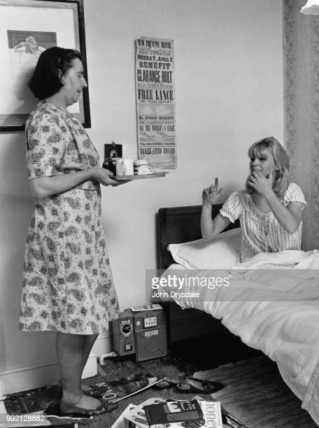 British actress Julie Christie is brought breakfast in bed by her landlady at her rented accommodation in Birmingham UK 7th October 1963 A...