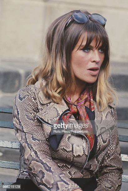 British actress Julie Christie pictured wearing a snakeskin jacket and silk scarf in October 1967