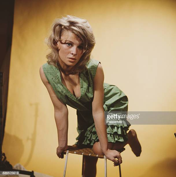 British actress Julie Christie who plays Andromeda in the science fiction television drama A for Andromeda posed kneeling on a stool in 1962