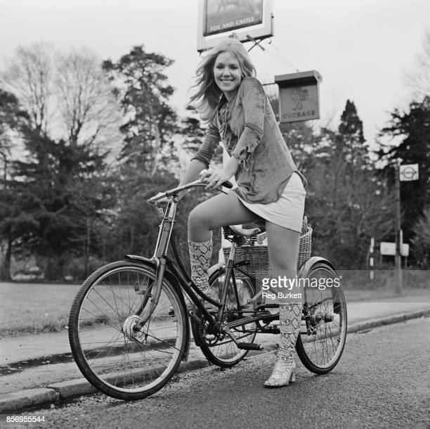 British actress Julie Samuel on her 60 years old tricycle 30th November 1970