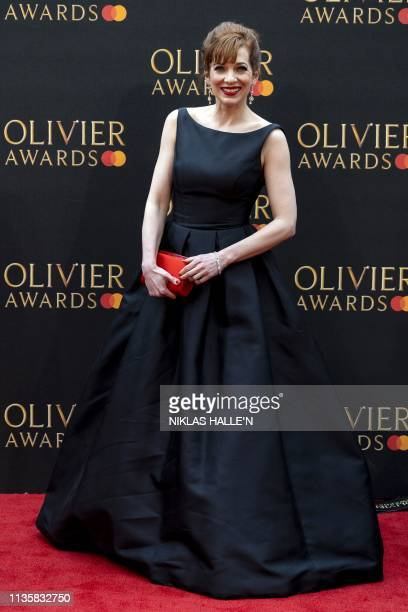 British actress Katherine Parkinson poses on the red carpet upon arrival to attend The Olivier Awards at the Royal Albert Hall in central London on...