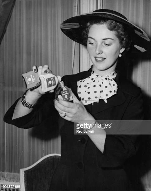 British actress Katie Boyle introduces a new foundation from the Crookes Laboratories at the Waldorf Hotel in London 28th April 1955 The set contains...