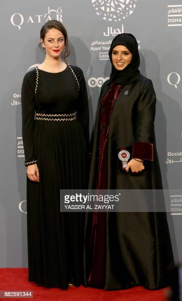 British actress Kaya Scodelario and Qatari Fatima alRemaihi CEO of Doha film institute and the director of Ajyal youth film festival pose on the red...