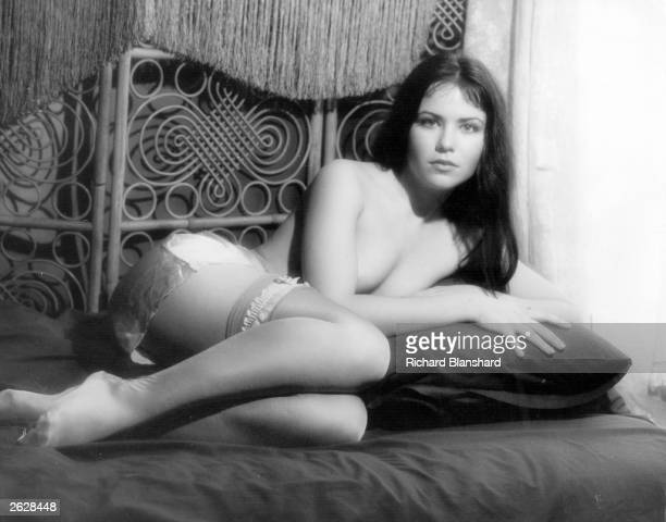 British actress Koo Stark lying seminaked on a bed in a scene from the erotic comingofage film 'Emily' Original Publication People Disc HM0454
