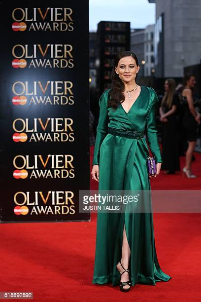 British actress Lara Pulver poses on the red carpet upon arrival to attend the 2016 Laurence Olivier Awards in London on April 3 2016 / AFP / JUSTIN...