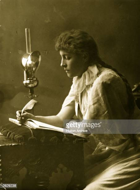 British actress Lillie Langtry writing by lamplight