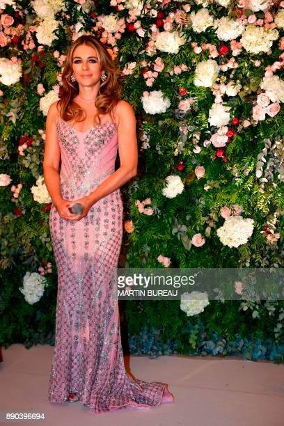 British actress Liz Hurley delivers a speech in Paris on December 11 2017 during a charity dinner in honour of Indian billionaire Sudha Reddy who...