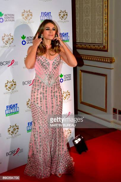 British actress Liz Hurley poses during a photocall in Paris on December 11 2017 during a charity dinner in honour of Indian billionaire Sudha Reddy...