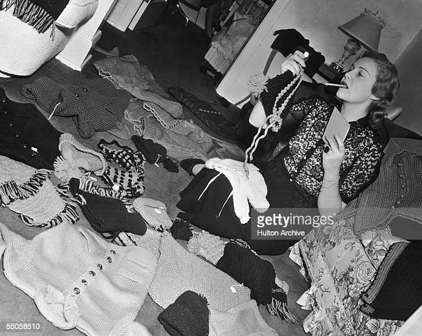 British actress Madeleine Carroll at home in California sorting children's knitwear to be sent to orphans in France during World War II circa 1942