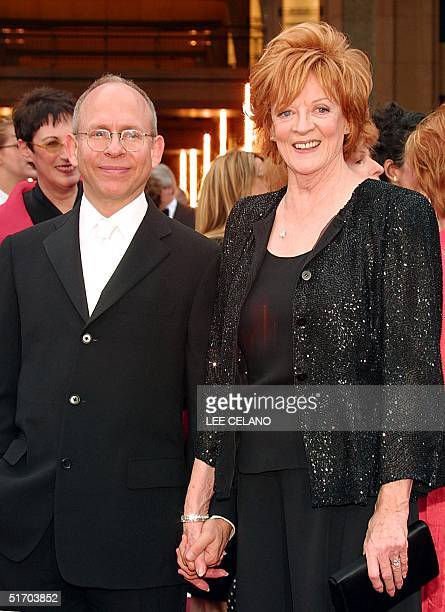 British actress Maggie Smith arrives with producer Bob Balaban 24 March 2002 at the Kodak Theater in Hollywood CA Smith is nominated for best actress...