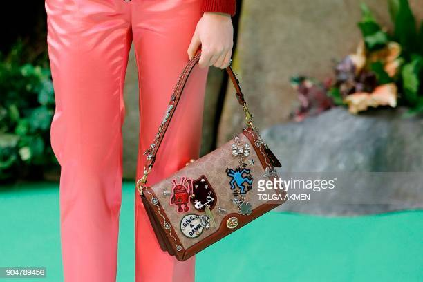 British actress Maisie Williams posing with a handbag on the carpet arriving to attend the world premiere of the film Early Man in London on January...