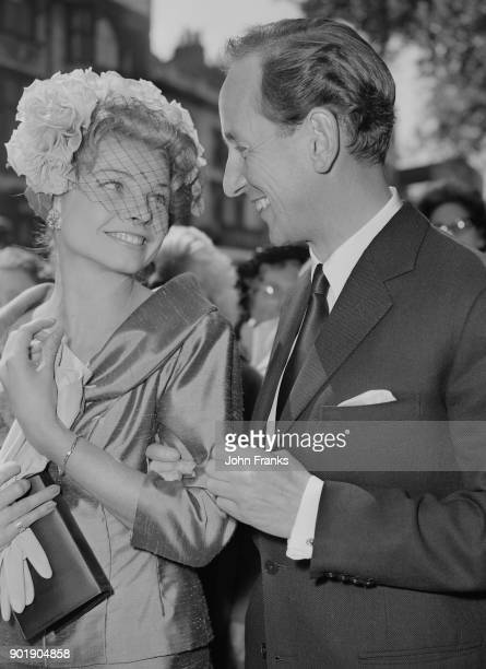 British actress Mary Peach and film producer Thomas Clyde leave Chelsea Registry Office in London after their wedding 18th May 1961