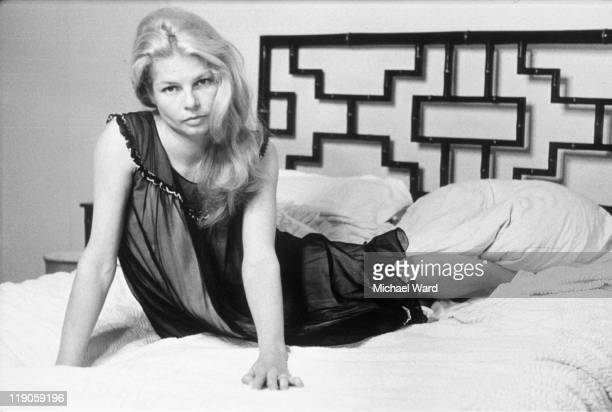 British actress Mary Peach posing on a bed 1964