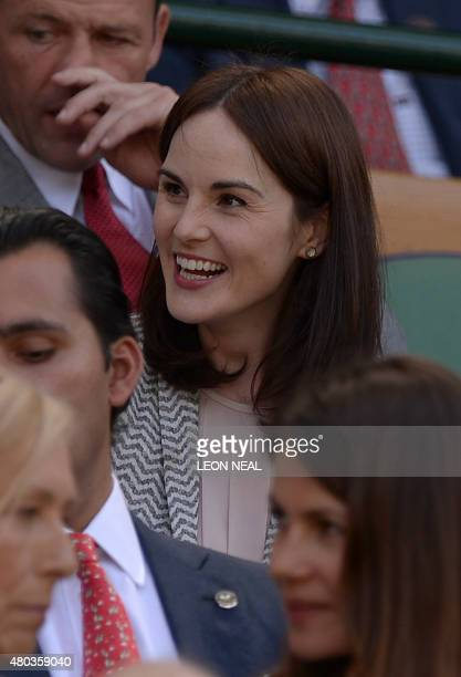 British actress Michelle Dockery takes her seat in the royal box on centre court to watch the women's singles final between US player Serena Williams...