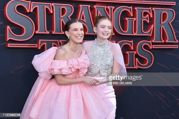 """British actress Millie Bobby Brown and US actress Sadie Sink attend Netflix's """"Stranger Things 3"""" premiere at Santa Monica high school Barnum Hall on..."""