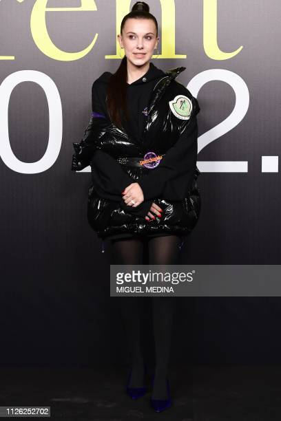 British actress Millie Bobby Brown poses during a photo call as she arrives to attend the Moncler women's Fall/Winter 2019/2020 collection fashion...