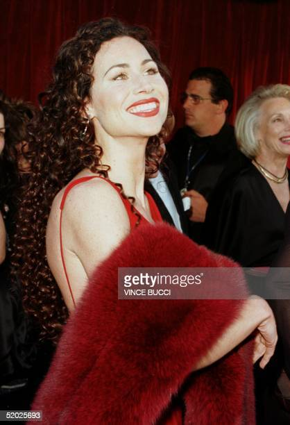 British actress Minnie Driver arrives for the 70th Annual Academy Awards in Los Angeles. Driver is nominated for Best Supporting Actress for her role...
