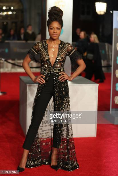 British actress Naomi Harris poses on the red carpet upon arrival at the BAFTA British Academy Film Awards at the Royal Albert Hall in London on...