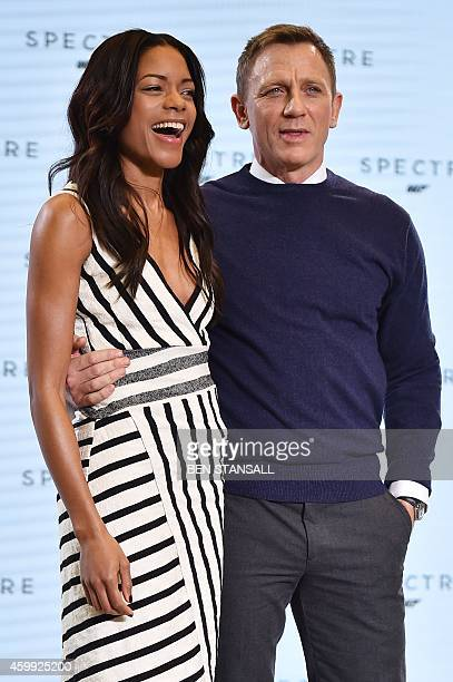 British actress Naomie Harris and British actor Daniel Craig pose during an event to launch the 24th James Bond film 'Spectre' at Pinewood Studios at...