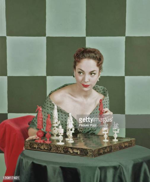 British actress Natasha Parry with a carved chess set 17th November 1955