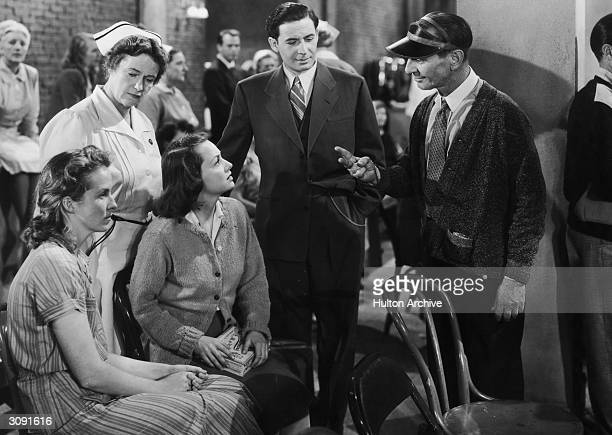 British actress Olivia De Havilland plays a mental patient under the care of Leo Genn in the film 'The Snake Pit' directed by Anatole Litvak for 20th...