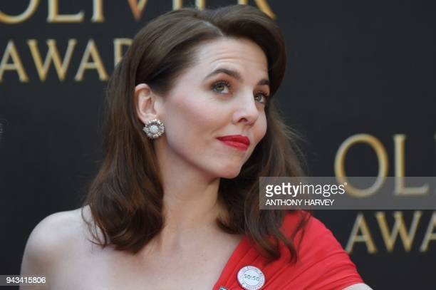 British actress Ophelia Lovibond poses on the red carpet upon arrival to attend The Olivier Awards at the Royal Albert Hall in central London on...