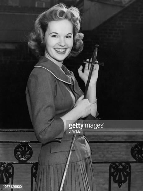 British actress Peggy Cummins holding a sword after being chosen to play Peter Pan in the Christmas performance of J M Barrie's famous play 2nd...