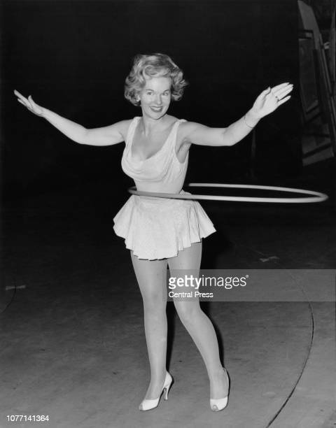 British actress Peggy Cummins rehearsing with a hula hoop at the London Palladium for the 'Night of a Hundred Stars' 19th July 1960 She will be...
