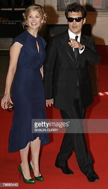 British actress Rosamund Pike and British film director Joe Wright arrive for the British Academy of Film and Television Awards in central London on...