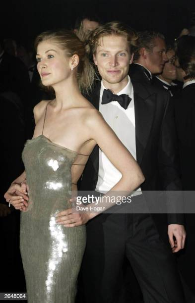British actress Rosamund Pike and friend attend the world premiere of the James Bond film 'Die Another Day' at the Royal Albert Hall on November 18...