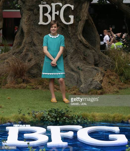 British actress Ruby Barnhill poses as she arrives to attend the UK premeiere of the film The BFG in Leicester Square central London on July 17 2016...