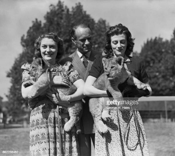British actress Sarah Churchill the daughter of Prime Minister Winston Churchill with her husband comedian Vic Oliver and Jane one of the lions cubs...