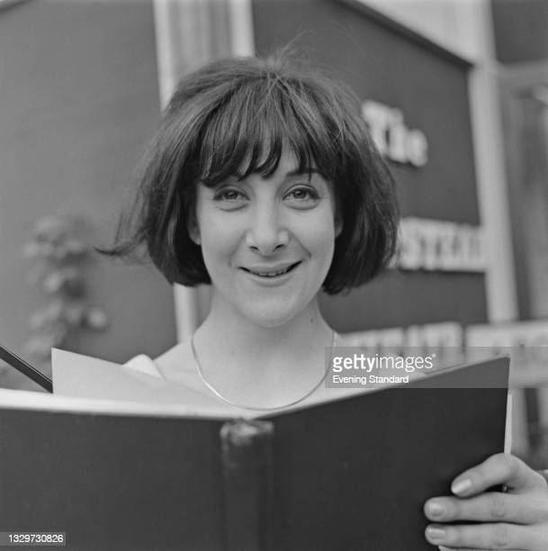 British actress Sheila Steafel outside the Hampstead Theatre Club in London, UK, 17th June 1965. She is starring in the play 'Splits on the...