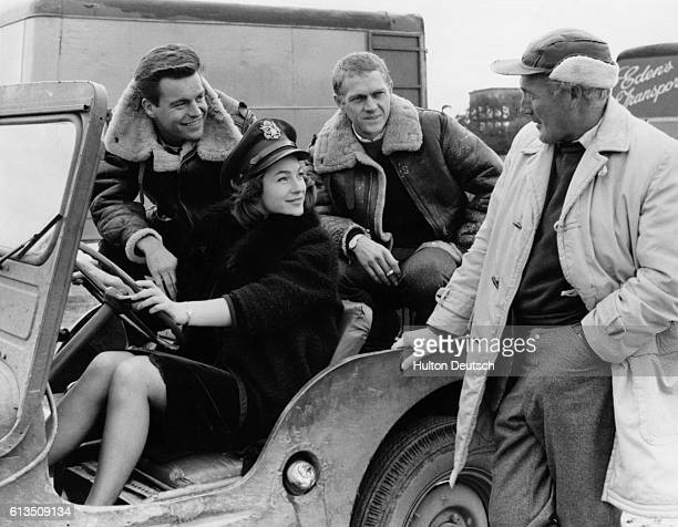 British actress Shirley Ann Field with American actors Robert Wagner and Steve McQueen talking to director Philip Leacock during location shooting of...
