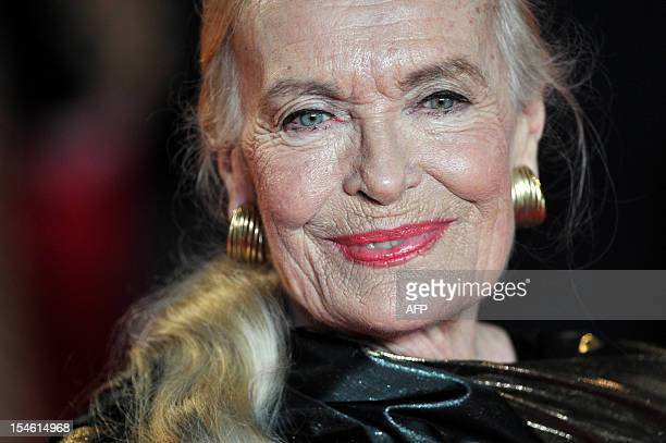British actress Shirley Eaton poses on the red carpet as she attends the royal world premiere of the new James Bond film 'Skyfall' at the Royal...