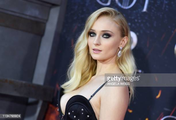 British actress Sophie Turner arrives for the Game of Thrones eighth and final season premiere at Radio City Music Hall on April 3 2019 in New York...