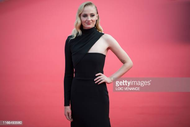 "British actress Sophie Turner poses on the red carpet as she arrives for the movie ""Heavy"" as part of the 45th Deauville US Film Festival, in..."