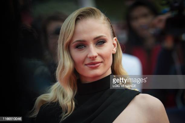"""British actress Sophie Turner poses on the red carpet as she arrives for the movie """"Heavy"""" as part of the 45th Deauville US Film Festival, in..."""