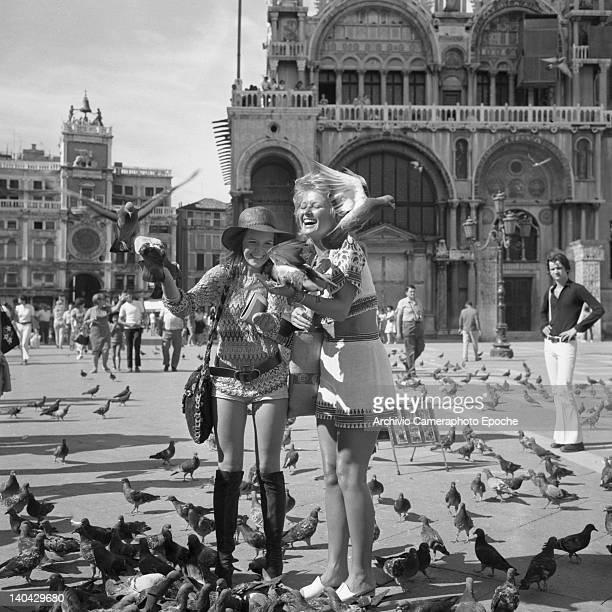 British actress Stephanie Beacham feeding pigeons with Verna Harvey in St Mark Square Venice 1971