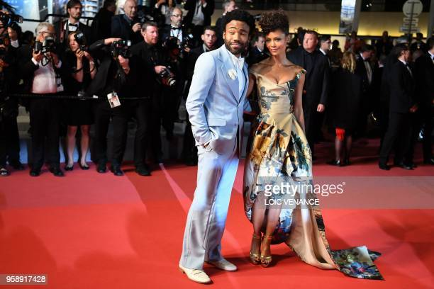 British actress Thandie Newton and US actor Donald Glover pose as they leave the Festival Palace on May 15 2018 after the screening of the film 'Solo...
