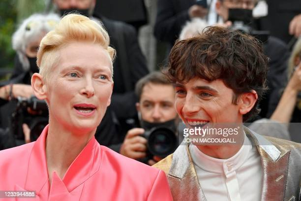 """British actress Tilda Swinton and French-Us actor Timothee Chalamet arrive for the screening of the film """"The French Dispatch"""" at the 74th edition of..."""
