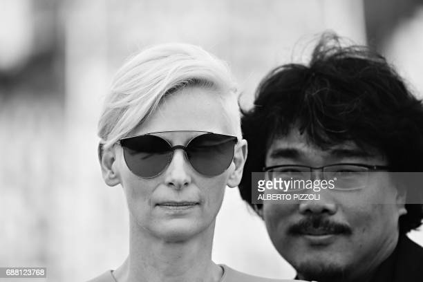 British actress Tilda Swinton and South Korean director Bong Joonho pose on May 19 2017 during a photocall for the film 'Okja' at the 70th edition of...
