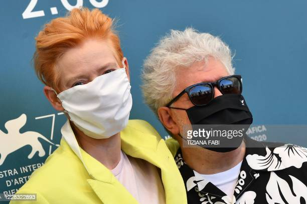 """British actress Tilda Swinton and Spanish director Pedro Almodovar, both wearing a face mask, attend a photocall for the film """"The Human Voice""""..."""