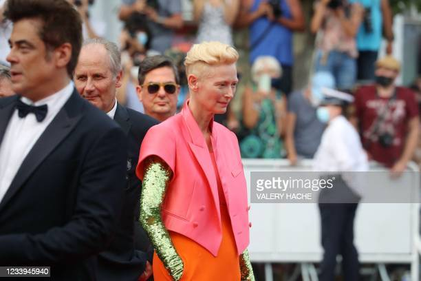 """British actress Tilda Swinton and Us actor Benicio Del Toro are pictured with other guests upon their arrival for the screening of the film """"The..."""