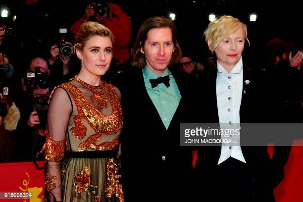 British actress Tilda Swinton and US actress and director Greta Gerwig pose with US director Wes Anderson upon their arrival at the Berlinale Palace...